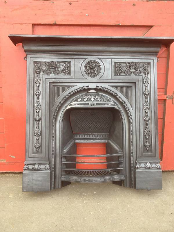 large arched combination fireplace. Comes with firebrick installed. cast iron 14546692426874