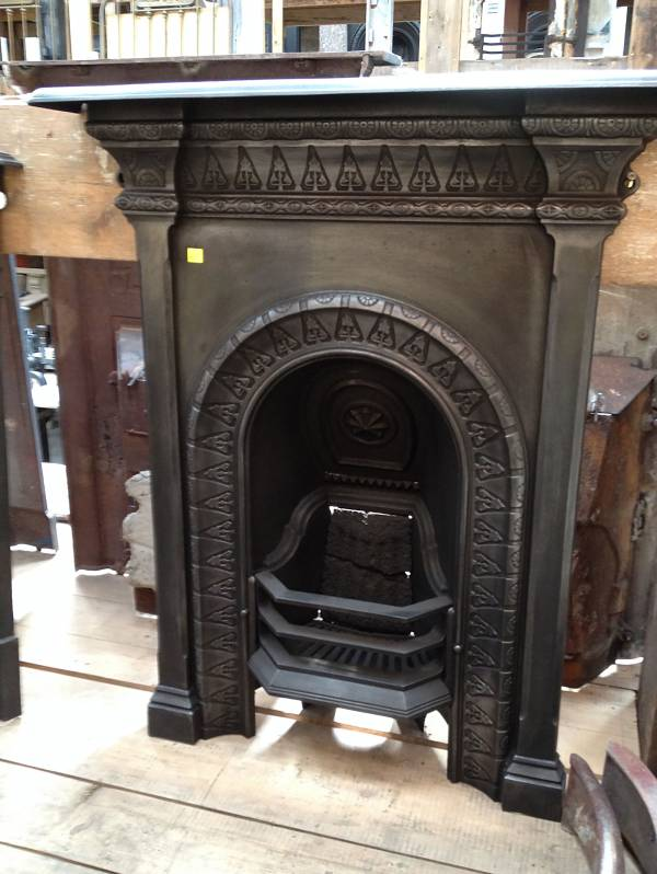 little arched fireplace. cast iron 14546692449505