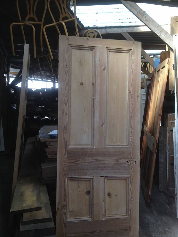 Stripped pine four panel door. 14546692169629