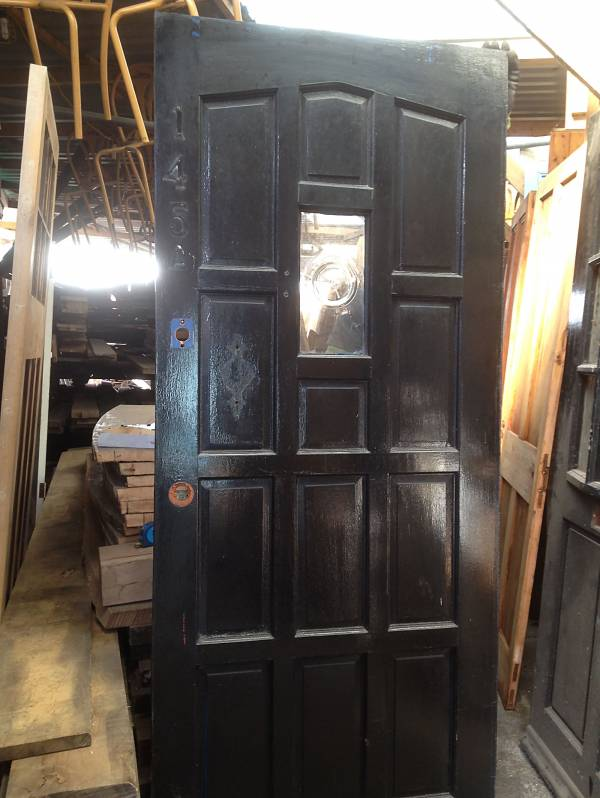 Hardwood paneled cottage style door with small glazed bottled bottom window. 14546692172889