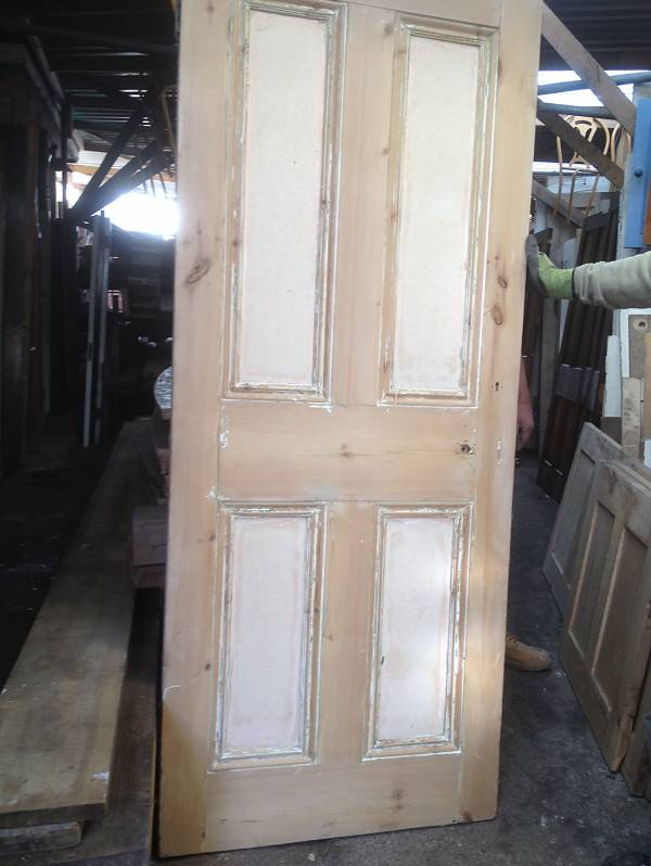 Stripped pine four panel door.Panels painted white.14546692204201