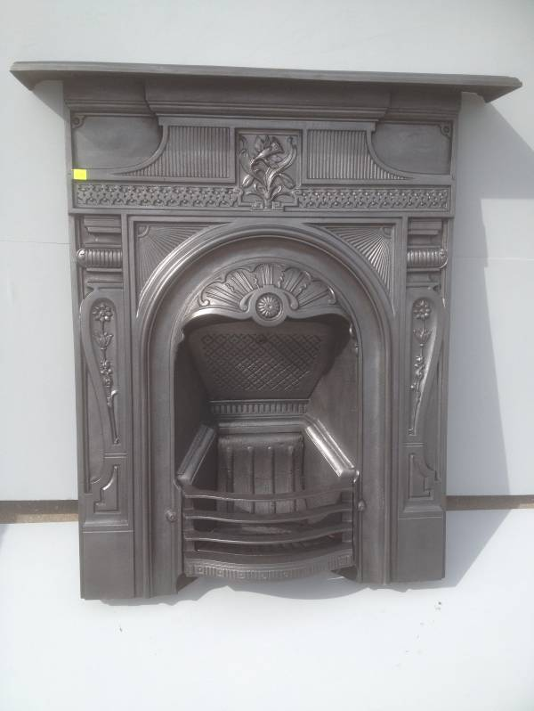 Black cast iron, arched combination fireplace