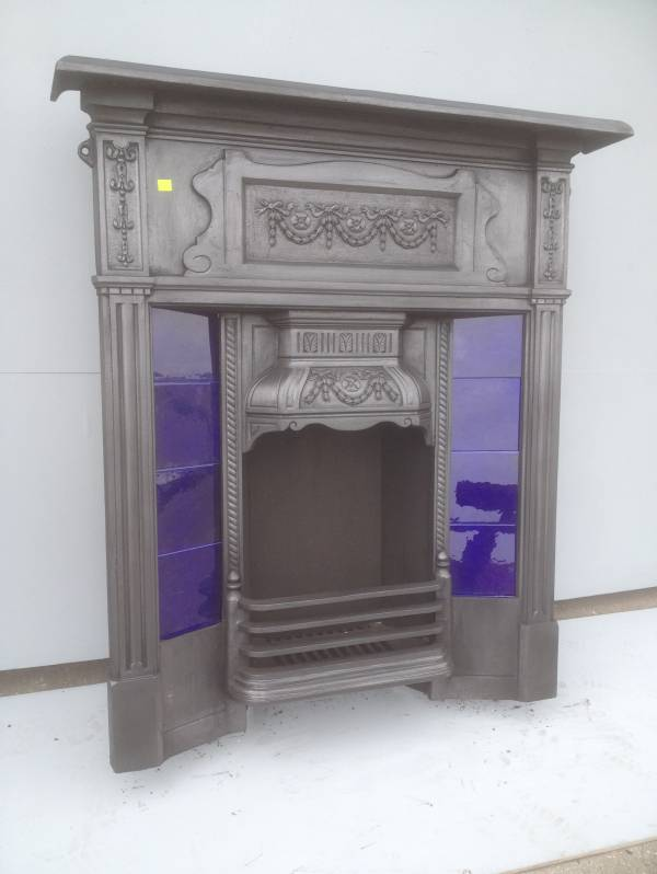 Black cast iron combination fire place, with blue tile insirts